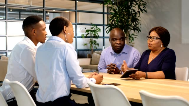 business meeting in the boardroom - four people stock videos & royalty-free footage