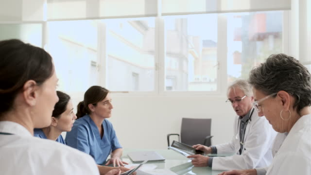 business meeting of a medical team at the hospital's board room. - administrator stock videos & royalty-free footage