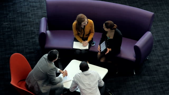 business meeting on sofa - lobby stock videos & royalty-free footage
