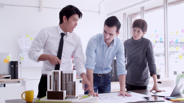Business meetings of real estate and company presidents to select a model to build a housing estate in writing and presenting to state organizations.Engineer meeting for architectural project. working with partner