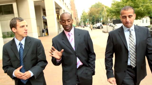 Business Men Walking in City