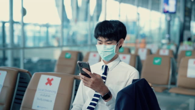 business men wear massages to protect against viruses while in the airport. - south east asia stock videos & royalty-free footage