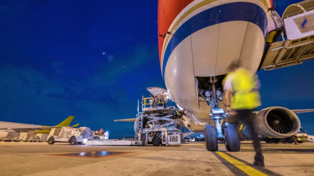 business of air cargo freighter with import and export at twilight sky - unloading stock videos & royalty-free footage
