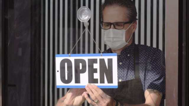 business owner opening after quarantine - small business stock videos & royalty-free footage