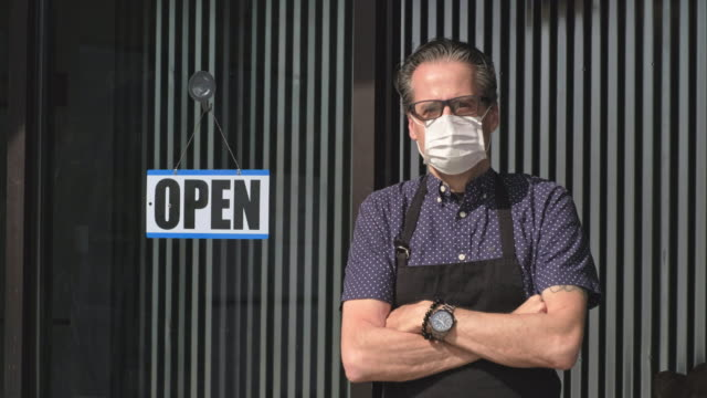 business owner opening after quarantine - politics and government stock videos & royalty-free footage