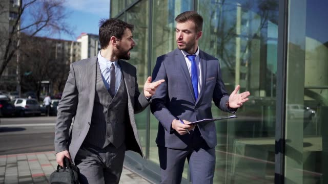 business partners making plan for meeting on the move - side by side stock videos & royalty-free footage