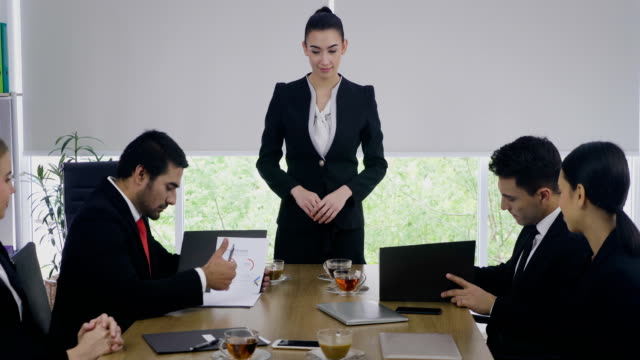 business partners signing contract making a deal and handshaking at meeting room - legal system stock videos & royalty-free footage