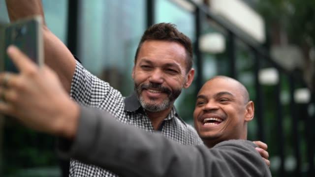business partners taking a selfie outdoors - pardo brazilian stock videos & royalty-free footage