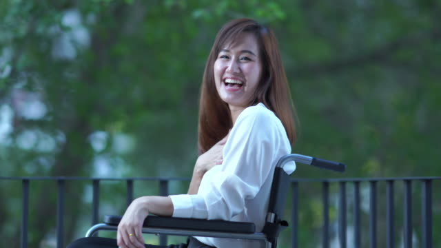 business patient woman  stting on wheelchair , feeling happiness at nursing home - wheelchair stock videos & royalty-free footage