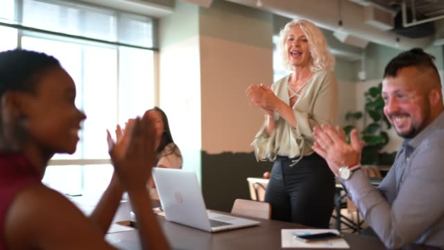 business people applauding and celebrating a presentation speech in a business meeting - congratulating stock videos & royalty-free footage