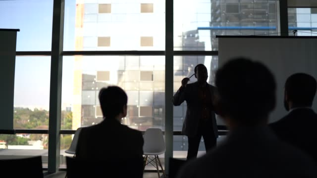 business people applauding in a seminar / workshop - with social distancing - silhouette stock videos & royalty-free footage