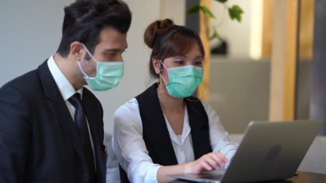 business people are working  on laptop and wear mask protect pollution or coronavirus - place of work stock videos & royalty-free footage