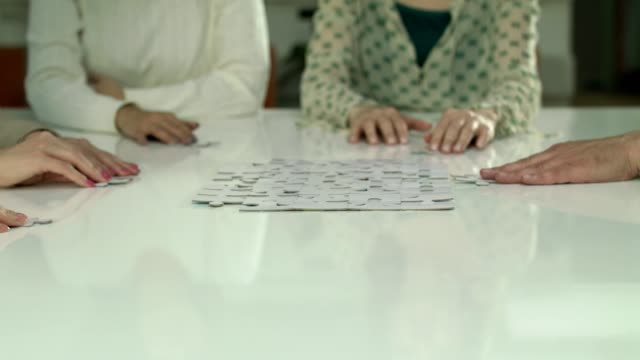 business people assembling puzzles - jigsaw puzzle stock videos & royalty-free footage