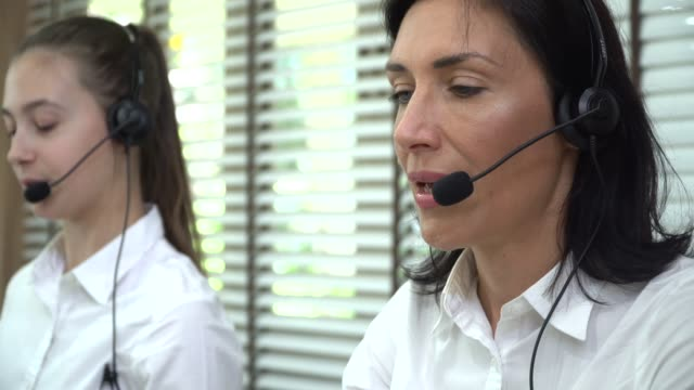 business people at call centre - animal call stock videos & royalty-free footage