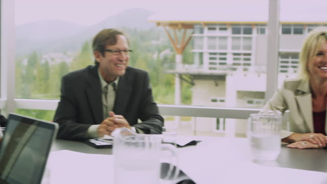 ms ds business people at meeting in board room, squamish, british columbia, canada - squamish stock videos & royalty-free footage
