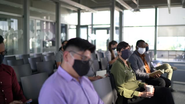 business people attending a seminar with social distancing and face mask - health and safety stock videos & royalty-free footage
