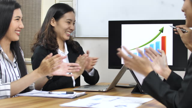 business people clapping for businessman in conference room - east asian culture stock videos & royalty-free footage