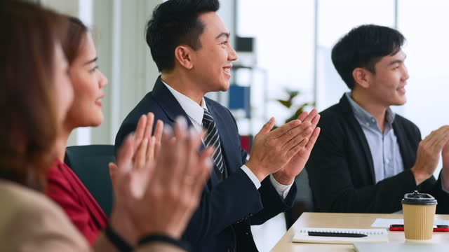 business people clapping hands after the finished meeting. professional education, work meeting, presentation or coaching concept. - finishing stock videos & royalty-free footage