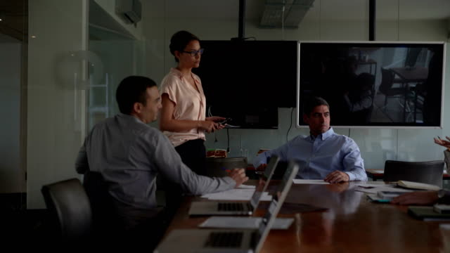 Business People Communicating At Conference Table