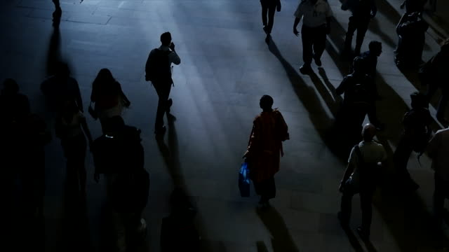 business people commuting on crowded street in the city. new york rush hour scene of anonymous pedestrians walking