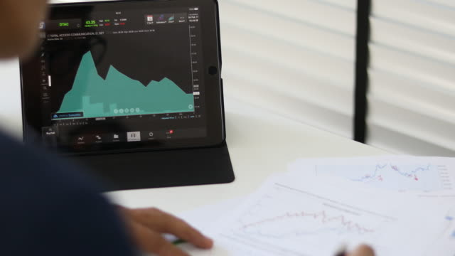 Business people developing a business project and analyzing market data