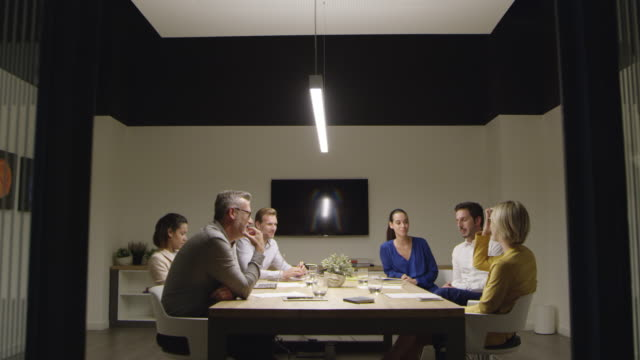 business people discussing at conference table - liquid crystal display television stock videos and b-roll footage