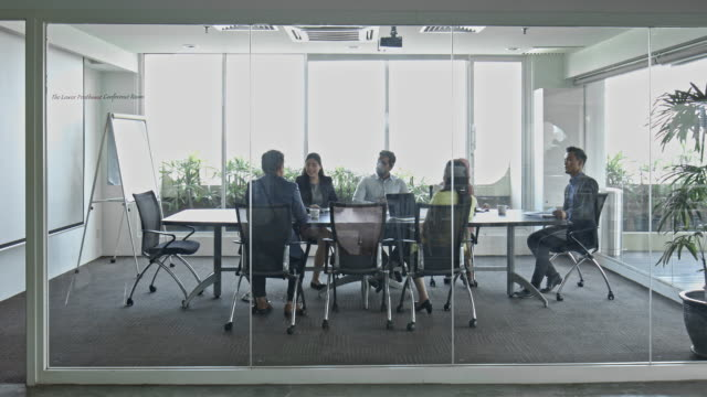 business people discussing in board room at office - chinese ethnicity stock videos & royalty-free footage