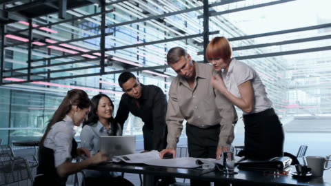 ms business people discussing over blueprint in cafeteria, los angeles, california, usa - europäischer abstammung stock-videos und b-roll-filmmaterial