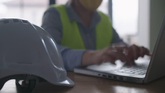 business people during covid-19 pandemic having online business meeting. close up of engineer in the new office setup, co-working with colleagues on a project distantly. brainstorming and teamwork. - hard hat stock videos & royalty-free footage