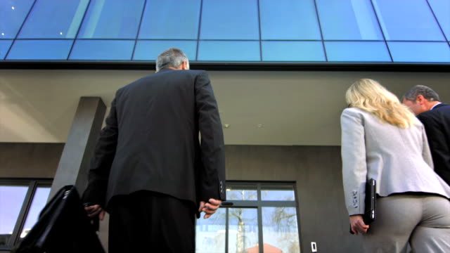 td business people going to work - building entrance stock videos and b-roll footage