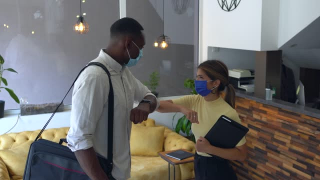 business people greeting during covid-19 pandemic, elbow bump - alternative lifestyle stock videos & royalty-free footage