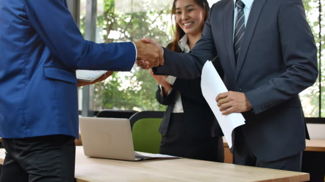 business people greeting - handshake stock videos and b-roll footage