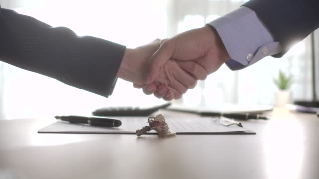 business people handshake after house rent - sales pitch stock videos & royalty-free footage