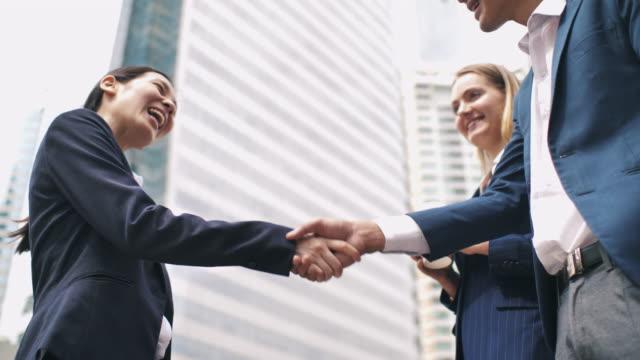 business people handshake in city,handshake greeting - business talk stock videos & royalty-free footage