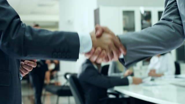 business people handshake - shaking stock videos & royalty-free footage