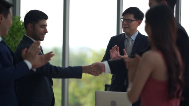 business people  handshaking  business team and  applauding to career achievement - ladder of success stock videos & royalty-free footage