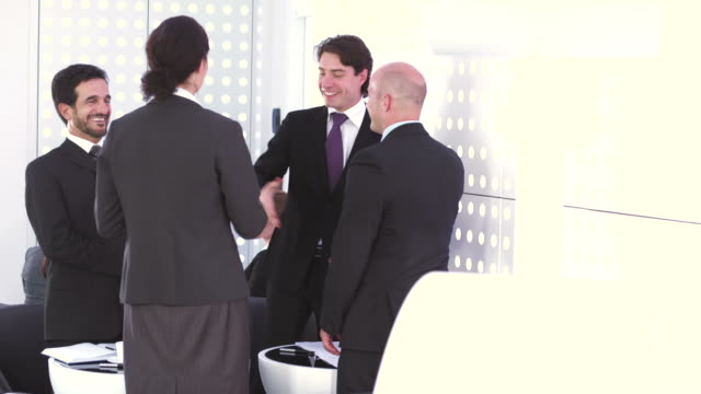 HD: Business People Handshaking In The Café