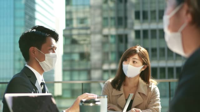 business people have a meeting with social distancing wearing protective mask in asia - japanese culture stock videos & royalty-free footage