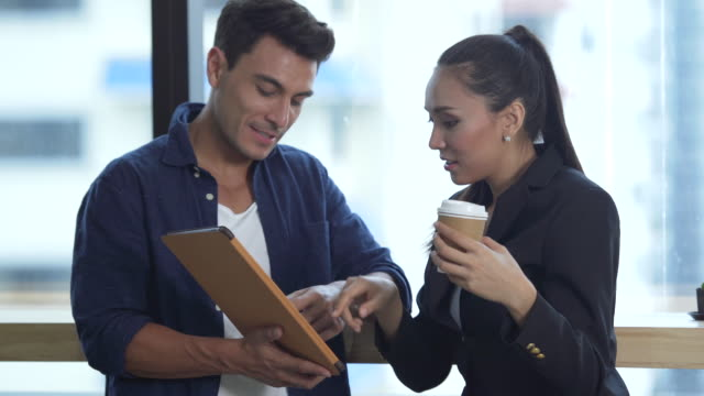 business people having a discussing with digital tablet - coffee break stock videos & royalty-free footage