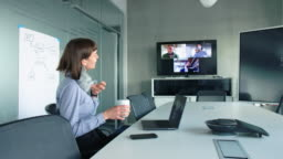 Business people having a video conference in office boardroom