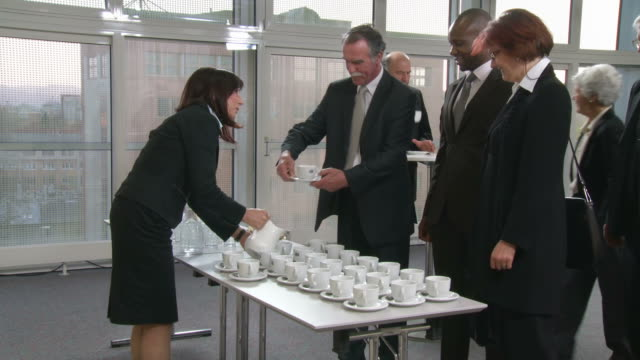 HD: Business People Having Coffee Break