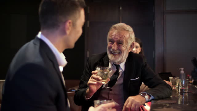 business people having drink  after work - social gathering stock videos & royalty-free footage