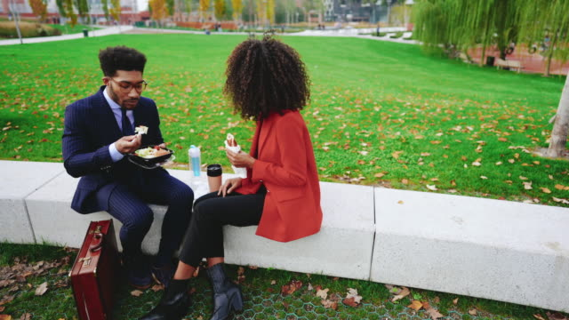 business people having lunch break outdoors - lunch stock videos & royalty-free footage