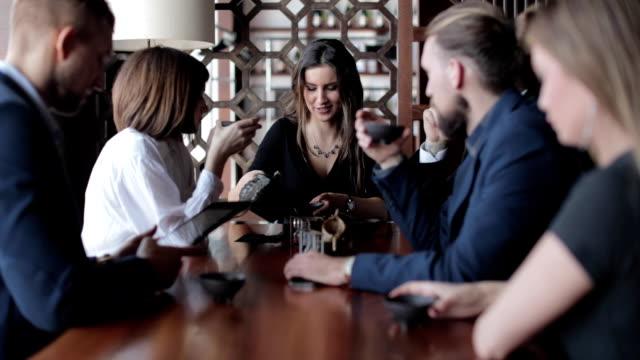 Business people having tea in restaurant