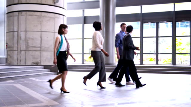 business people in business lobby - small group of people stock videos & royalty-free footage