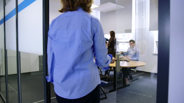 business people in conference room for a presentation - office doorway stock videos & royalty-free footage