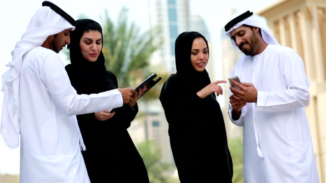 business people in dubai having a conversation - middle eastern ethnicity stock videos & royalty-free footage