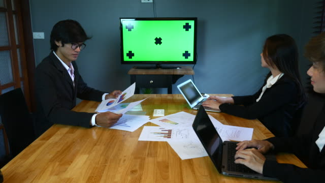 business people in front of chroma key monitor - media training stock videos and b-roll footage