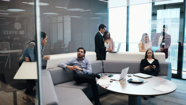 business people in it start-up company working together in common office space. - anticipation video stock e b–roll