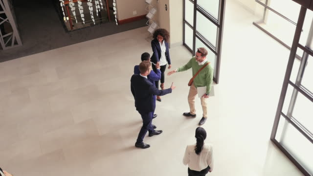 business people in office lobby - building entrance stock videos & royalty-free footage